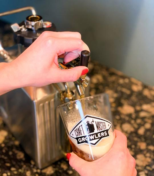 Pouring a pint of beer from our 128 oz stainless steel pressurized growler.